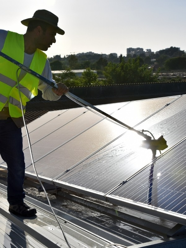 Man cleaning a solar panel
