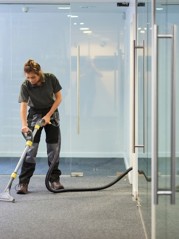 person doing a steam carpet cleaning